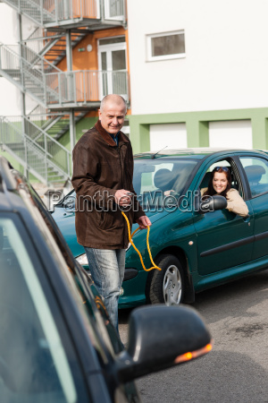 man helping woman with her broken