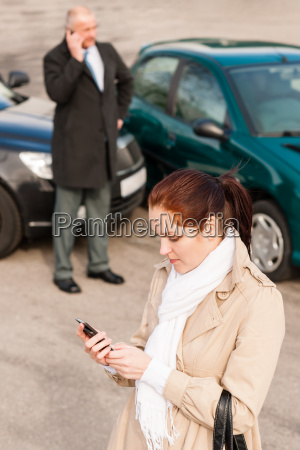 woman calling insurance after car accident
