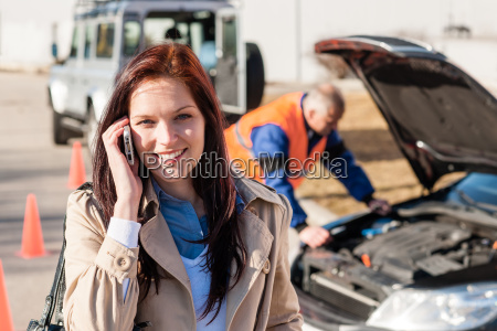 woman talking on cellphone after car