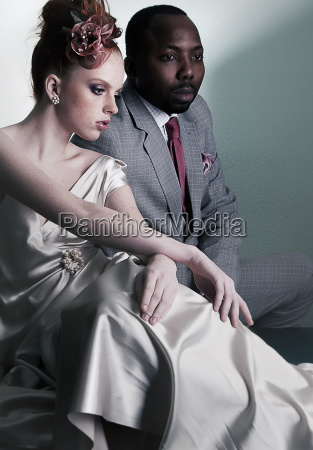 two fashion models sitting black