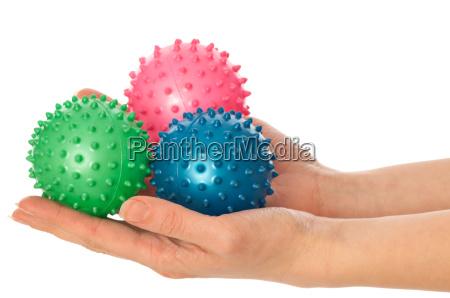 three colored massage balls