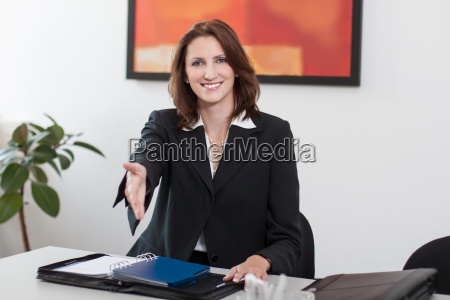 attractive businesswoman shakes hands