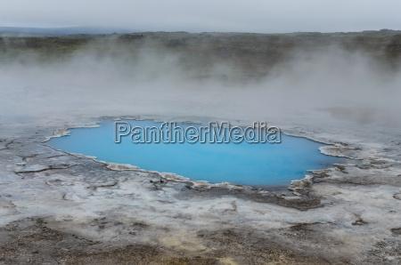 detail of blue geothermal pond in
