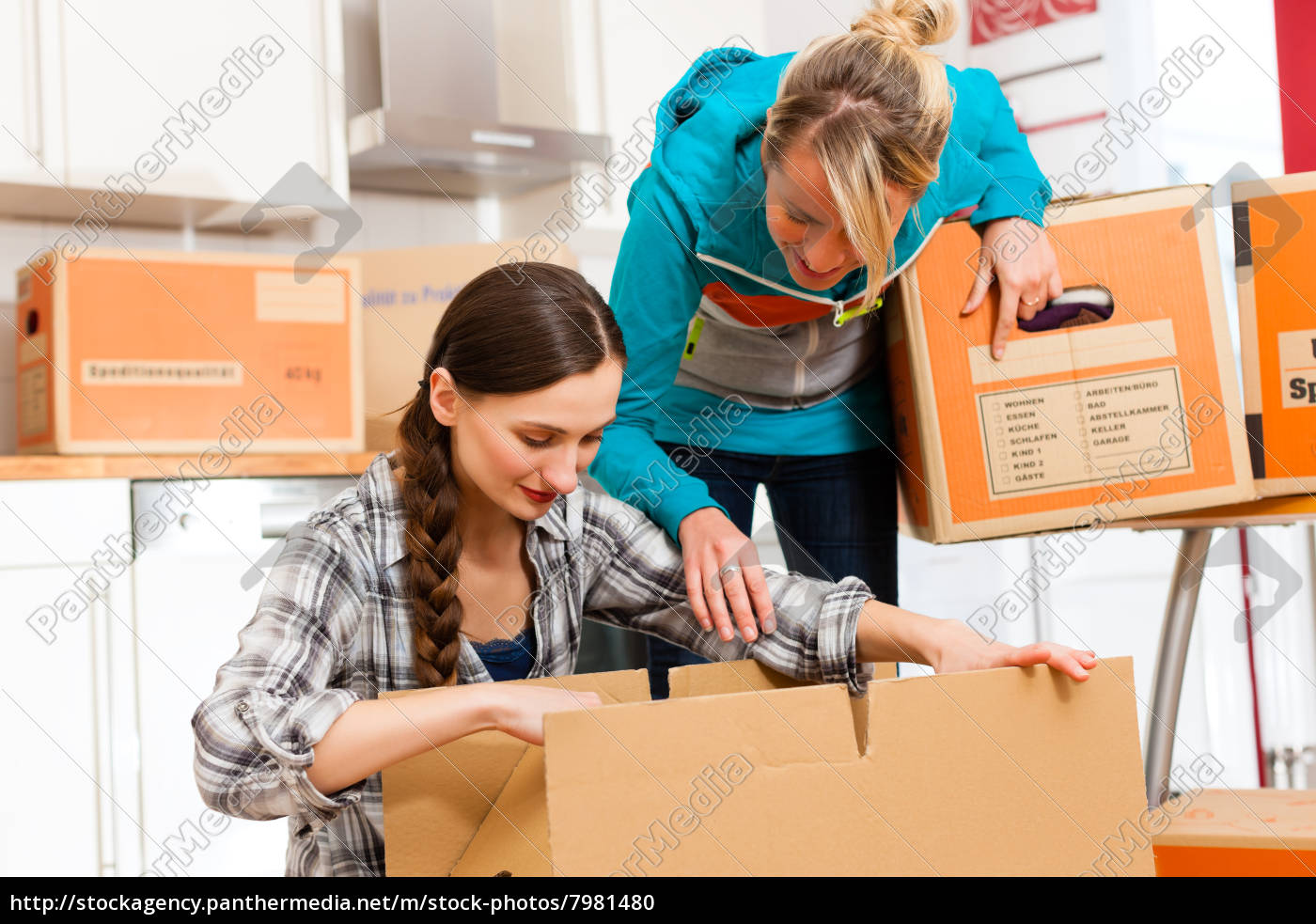 two, women, with, moving, box, when - 7981480