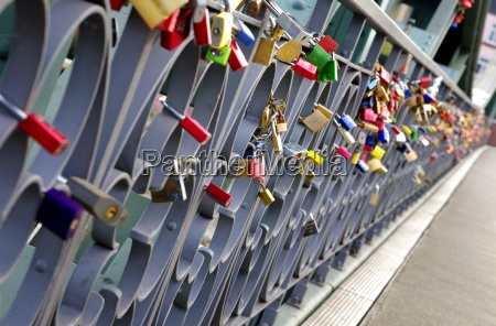 locks on the bridge railing in