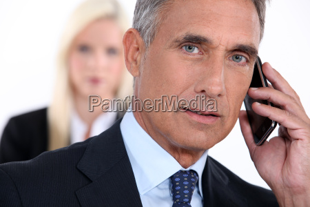 senior businessman on white background