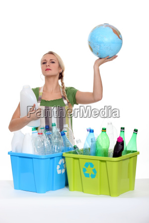 woman recycling and holding planet earth