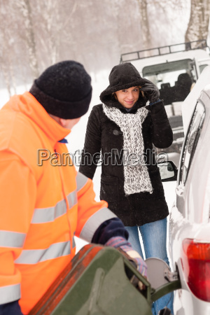 man filling gas tank car breakdown