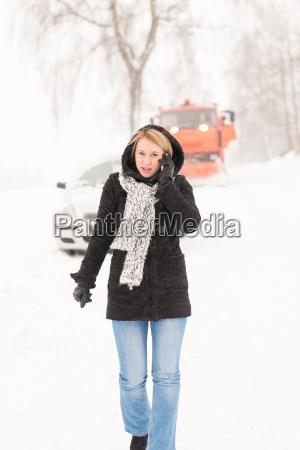 woman calling for help broken car