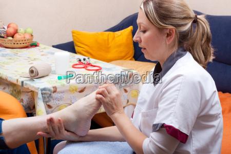 elderly nurse cares for a patients