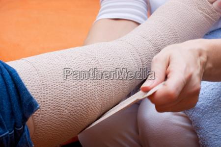 nurse bandages a patients foot