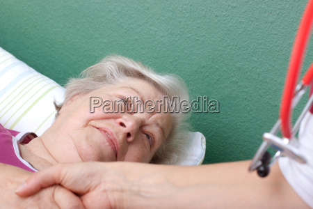 patient greets doctor lying in bed