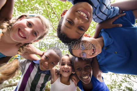 children embracing in circle around the