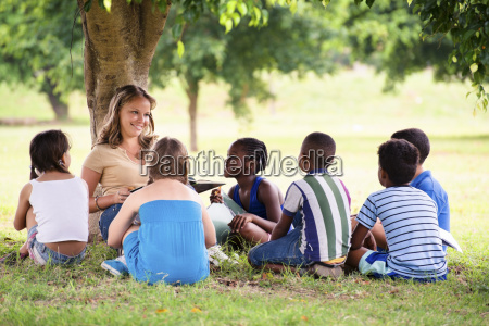 children and education teacher reading book