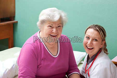patient and doctor laugh with a