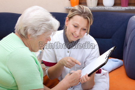 senior and nurse sit together data