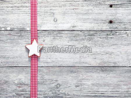 christmas star biscuit and festive ribbon