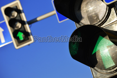 traffic lights over a blue sky