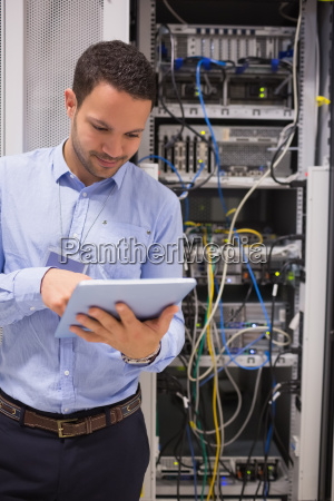 man in data centre using a