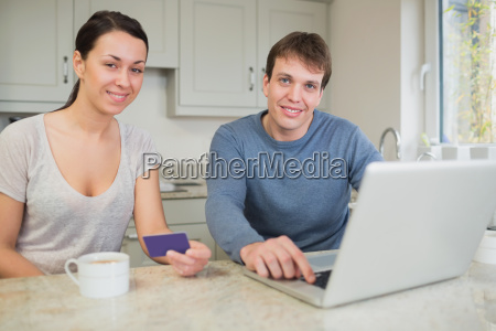 young, couple, shopping, online, on, laptop - 8067856