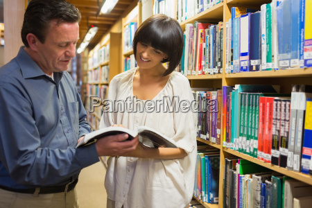 man and woman smiling and reading
