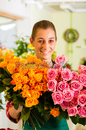 florist with flowers in flower shop