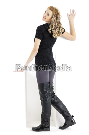 standing woman wearing black clothes and