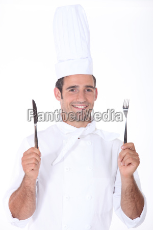 chef in whites holding a knife