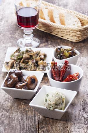 various italian antipasti and red wine