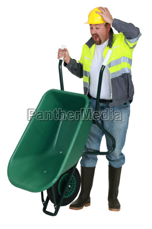 man with a wheelbarrow having an