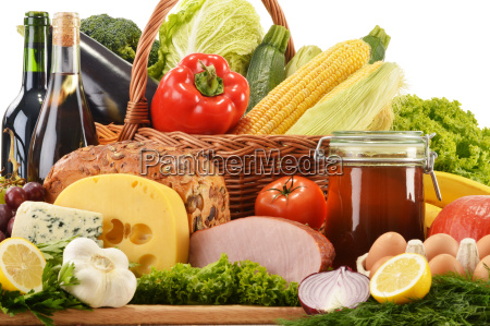 composition with groceries in wicker basket