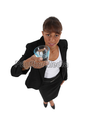 businesswoman holding glass of water
