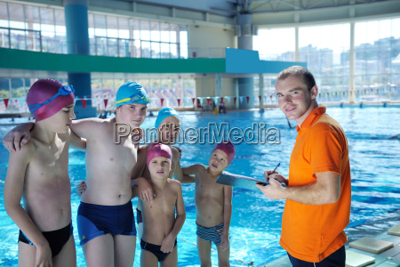 happy children group at swimming