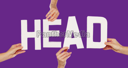 female hands holding letters head