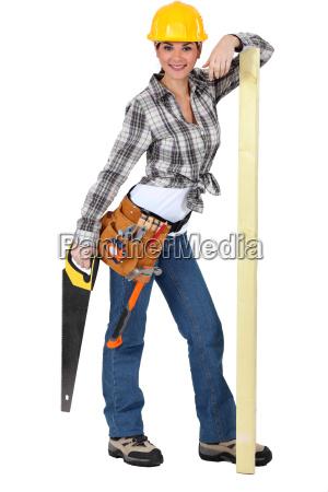 confident female carpenter standing on white