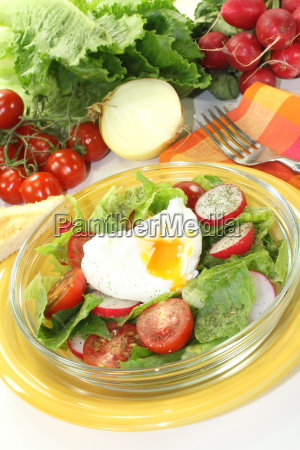salad with poached egg and tomatoes