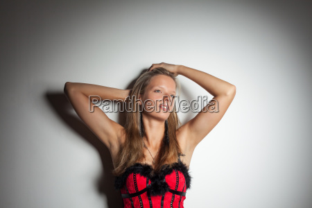 young woman in a red corset