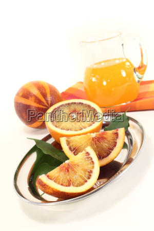 two blood oranges with juice