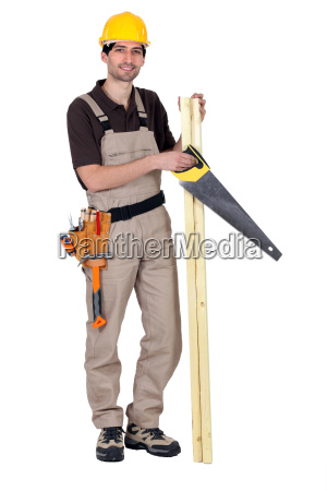 worker holding plank of wood and