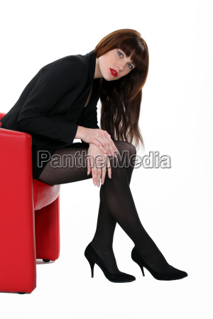 woman wearing tights and high heels