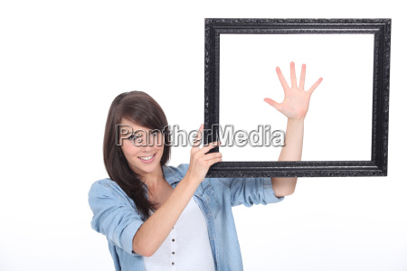 young brunette with picture frame