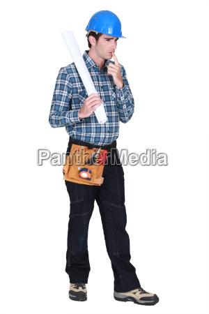 full length portrait of carpenter looking