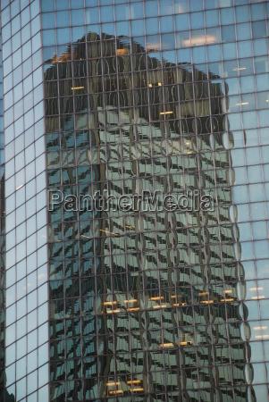 reflection high rise new york manhattan
