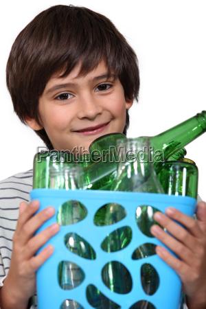 boy with empty bottles