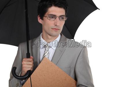 serious businessman with an umbrella