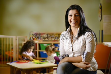 happy teacher with children eating in