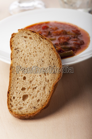 bread slice in front of goulash