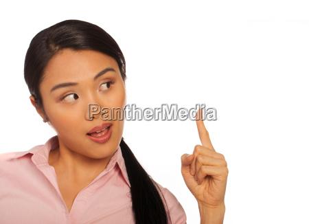 asian woman pointing upwards