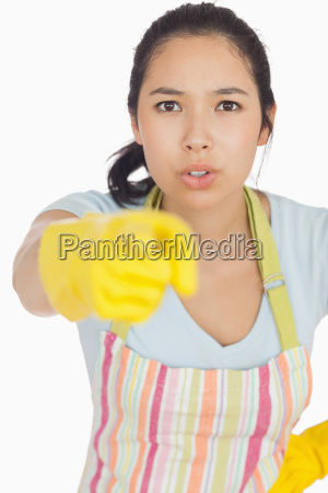 accusing woman in apron and rubber