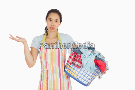 puzzled look young woman holding laundry